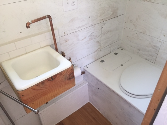 The Bathroom In Tiny House Has A Composting Toilet Sink And Full Sized Shower