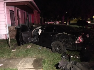 Stolen car crashes into homes after police chase