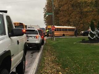 15 students hurt after school bus, truck collide