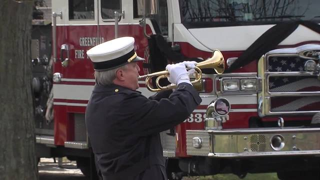 TAPS and flag folding at fallen Greenfield firefighter-s funeral