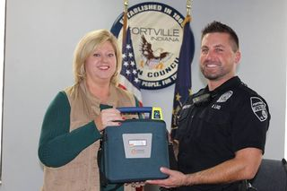 Fortville police gifted AED from non profit
