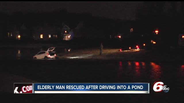 Elderly man drives car into freezing water of a retention pond