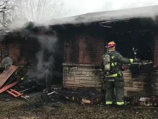 Neighbor helps children after house fire