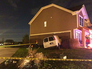 Van crashes into Fishers house, driver flees