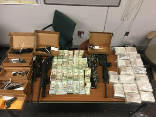 IMPD finds drugs, guns, $91K in cash after chase