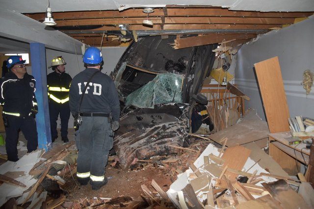 Car crashes into house, ends up in basement