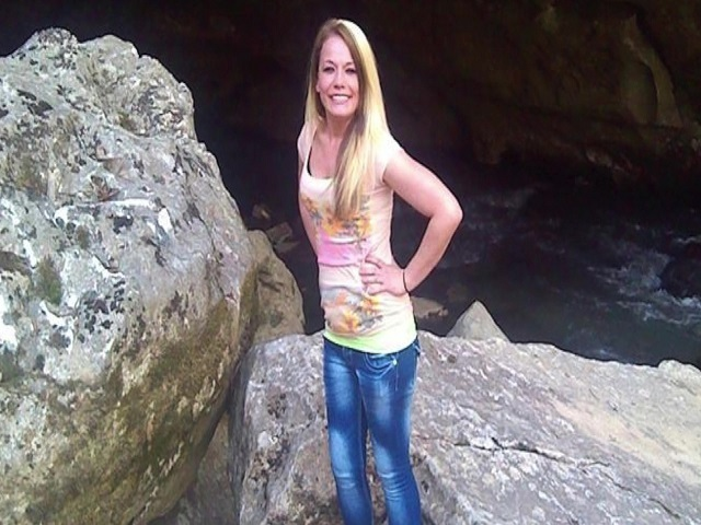 Body found by creek identified as missing woman