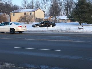 2 children injured as car slides into bus stop