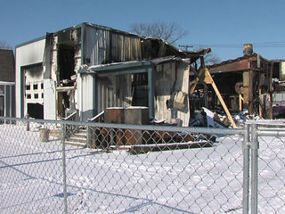 Auto body shop owner tries to rebuild after fire