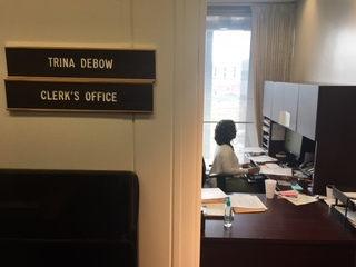 Fired City-County Council clerk back on the job