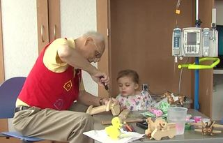 Volunteer gives kids comfort with wooden toys