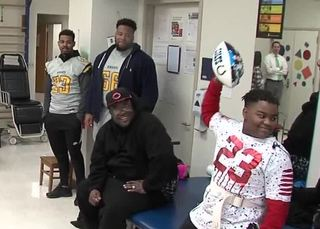 Boy paralyzed in shooting vows to play football