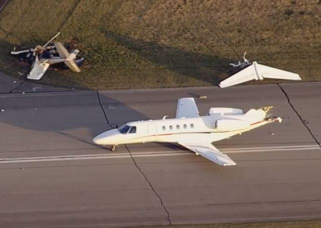 Runway plane collision in US midwest kills two