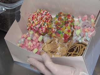 Chose toppings, icing at Quack Daddy Donuts
