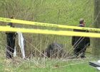 Neighborhood cleanup crew finds body near creek