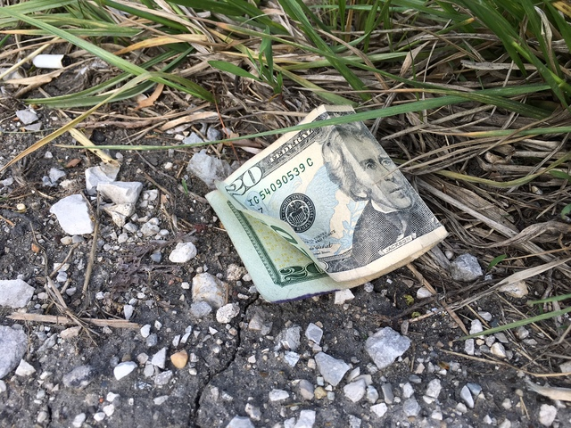 Brinks truck spills money onto I-70