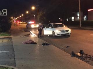 Man walking in road struck by vehicle
