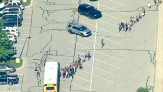 Teacher, student wounded in school shooting