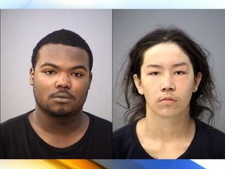 Police: 2 arrested for stealing officer's rifle