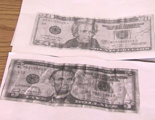 Anderson store owner helps track down fake money