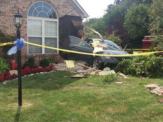 Car crashes into Carmel residence
