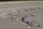 Fight over Morgan Co. road leaves holes unfilled